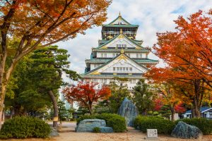 Osaka Castle in autumn in Japan OSAKA, JAPAN - NOVEMBER 18: Osaka Castle in Osaka, Japan on November 18, 2013. One of Japan's most famous and played a major role in the unification of Japan during the 16th century